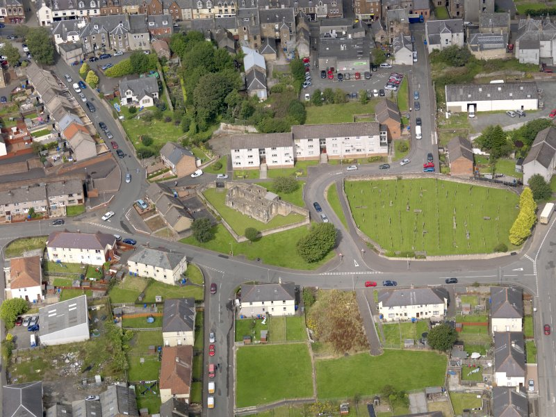 Oblique aerial view of Maybole, centred on St Mary's Church, taken from the SE.