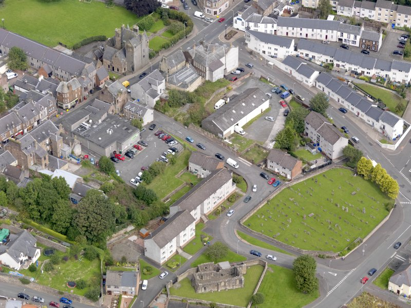 Oblique aerial view of Maybole, centred on St Mary's Church, taken from the S.