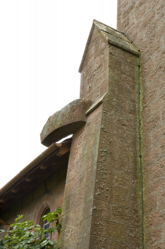 Detail of buttress head and stone spout on north of bell tower