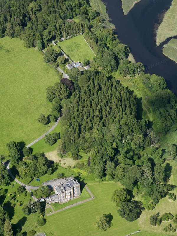 General oblique aerial view of Cumstoun House and policies, taken from the SSW.
