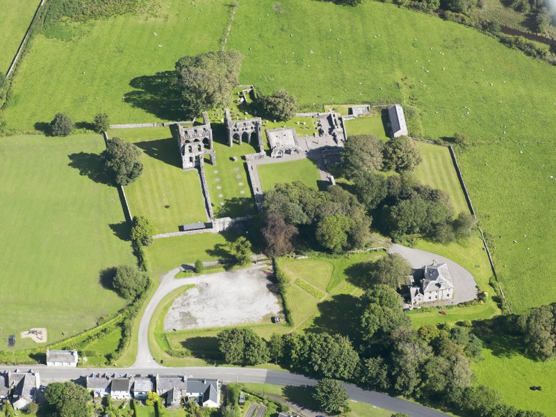 Oblique aerial view of Dundrennan Abbey, taken from the WNW.