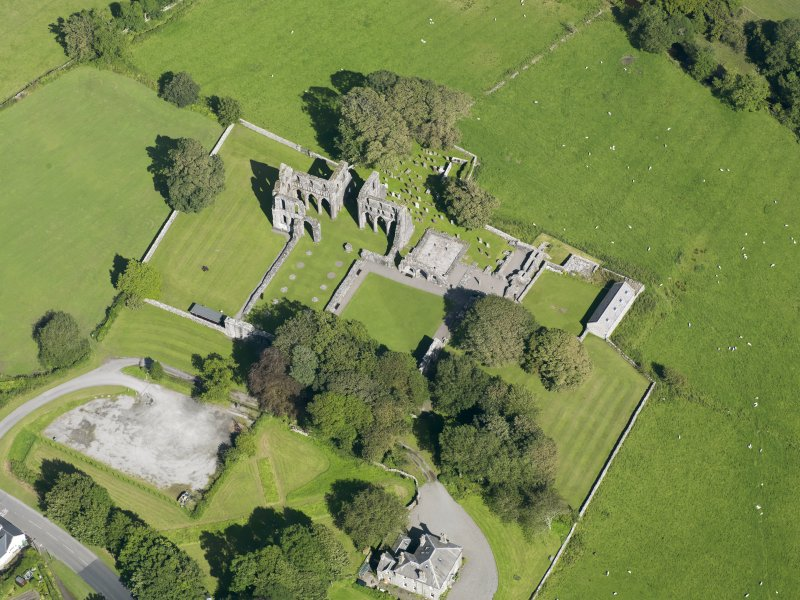 Oblique aerial view of Dundrennan Abbey, taken from the WSW.