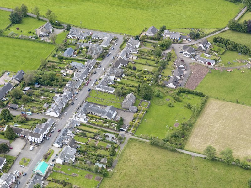 Oblique aerial view of the village centred on Gartmore Parish Church, taken from the NNE.