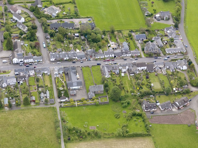 Oblique aerial view of the village centred on Gartmore Parish Church, taken from the NW.