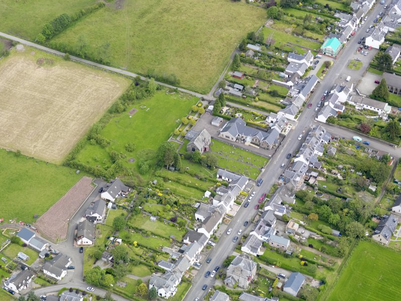 Oblique aerial view of the village centred on Gartmore Parish Church, taken from the S.