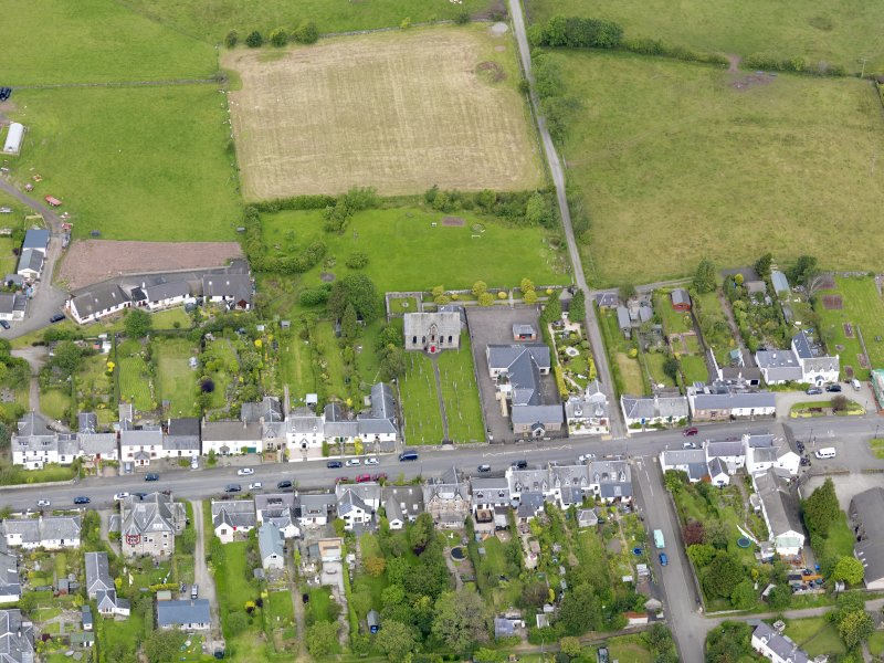Oblique aerial view of the village centred on Gartmore Parish Church, taken from the SE.