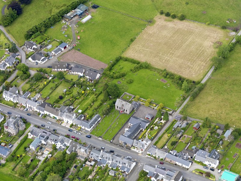 Oblique aerial view of the village centred on Gartmore Parish Church, taken from the ESE.