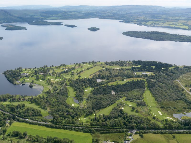 General oblique aerial view of Rossdhu House and Loch Lomond Golf Course, taken from the WNW.