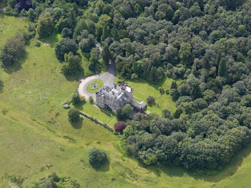Oblique aerial view of Auchendennan Castle, taken from the NNW.