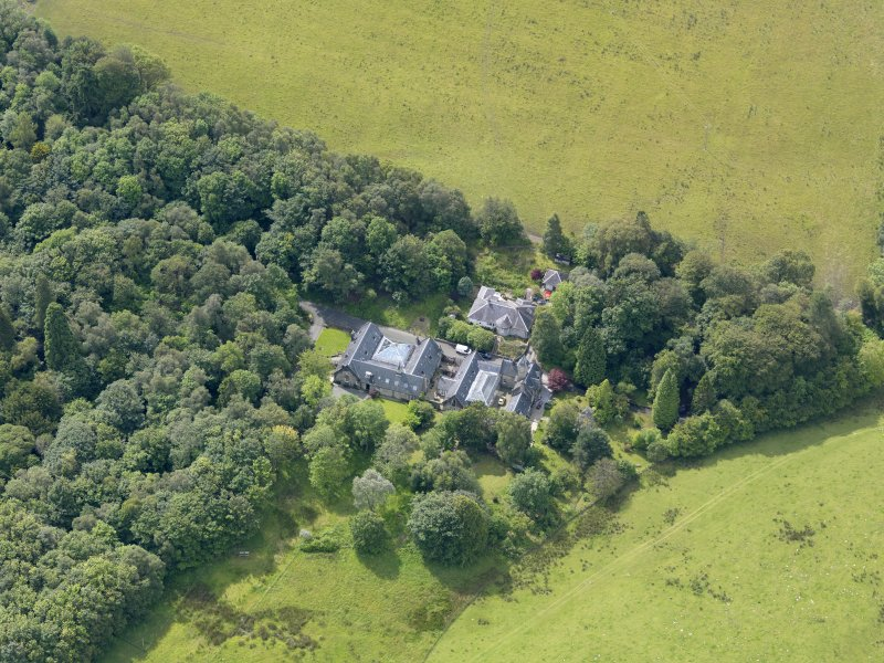 Oblique aerial view of Auchendennan Castle stables, taken from the N.