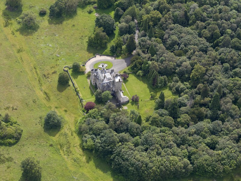 Oblique aerial view of Auchendennan Castle, taken from the NW.