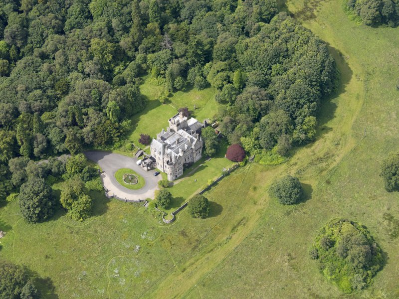 Oblique aerial view of Auchendennan Castle, taken from the ENE.