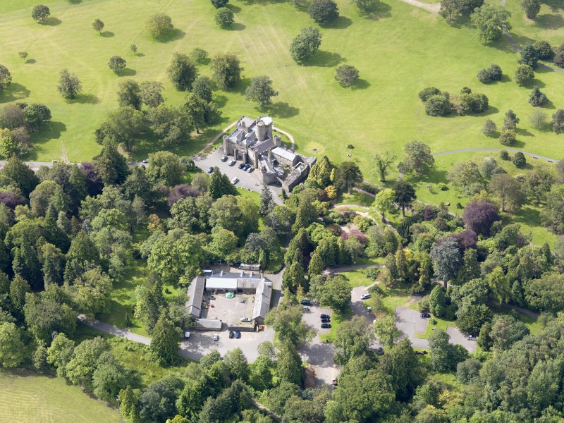 Oblique aerial view of Balloch Castle and stables, taken from the NE.