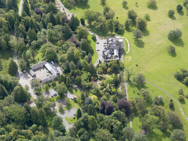 Oblique aerial view of Balloch Castle and stables, taken from the NNW.