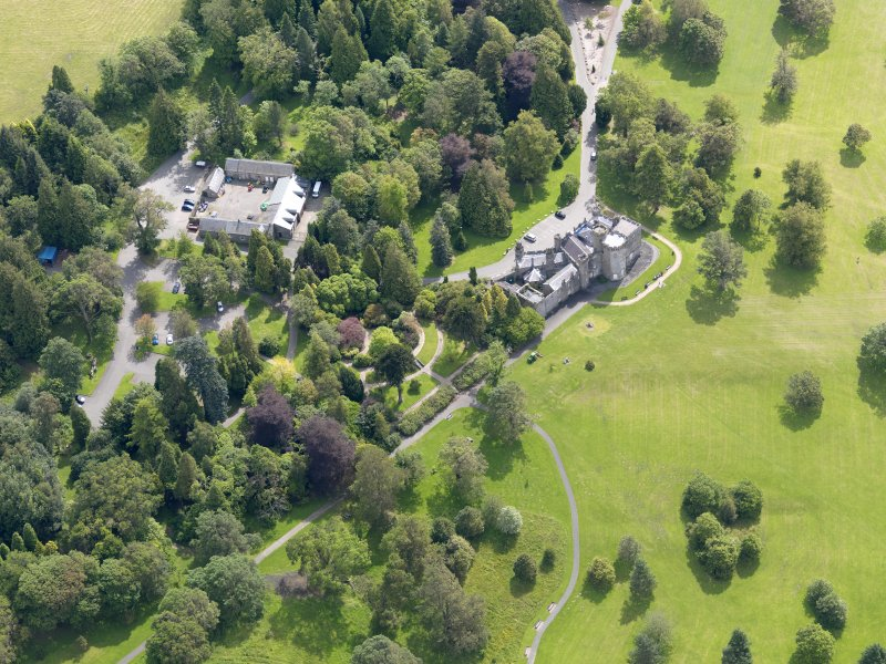 Oblique aerial view of Balloch Castle and stables, taken from the NW.