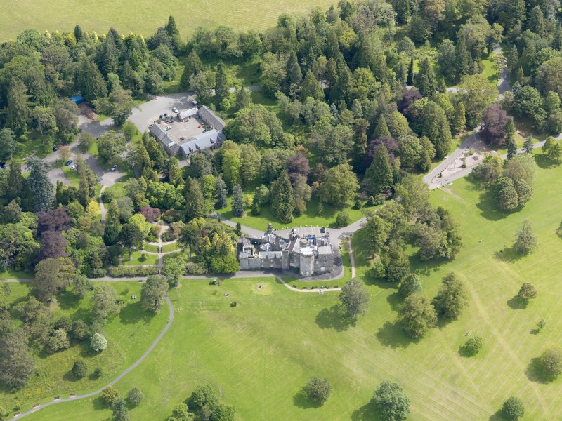 Oblique aerial view of Balloch Castle and stables, taken from the WSW.