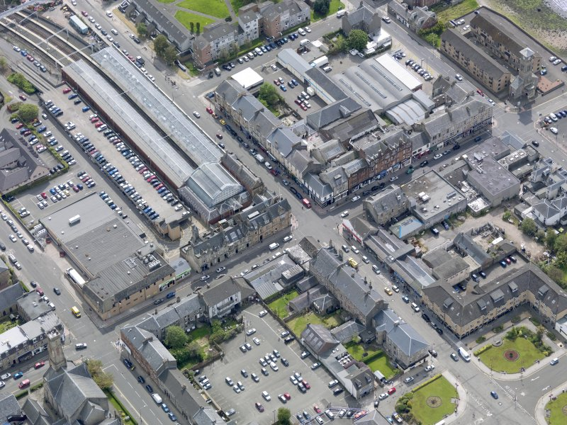 Oblique aerial view of Helensburgh Central Station and Council Offices, taken from the NW.