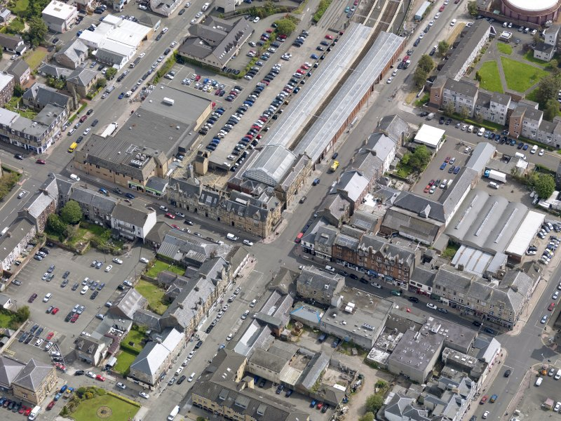 Oblique aerial view of Helensburgh Central Station and Council Offices, taken from the WSW.