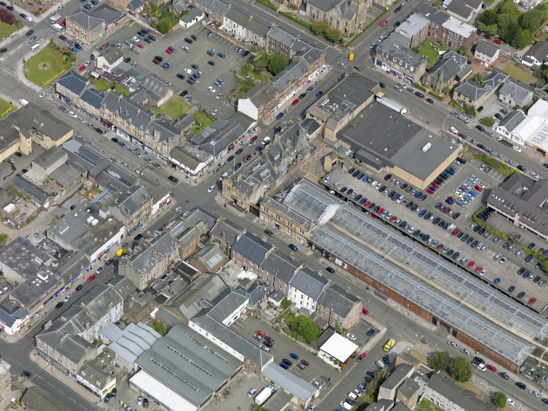 Oblique aerial view of Helensburgh Central Station and Council Offices, taken from the SSE.