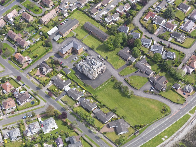 Oblique aerial view of Helensburgh, centred on Cairndhu House, taken from the SW.