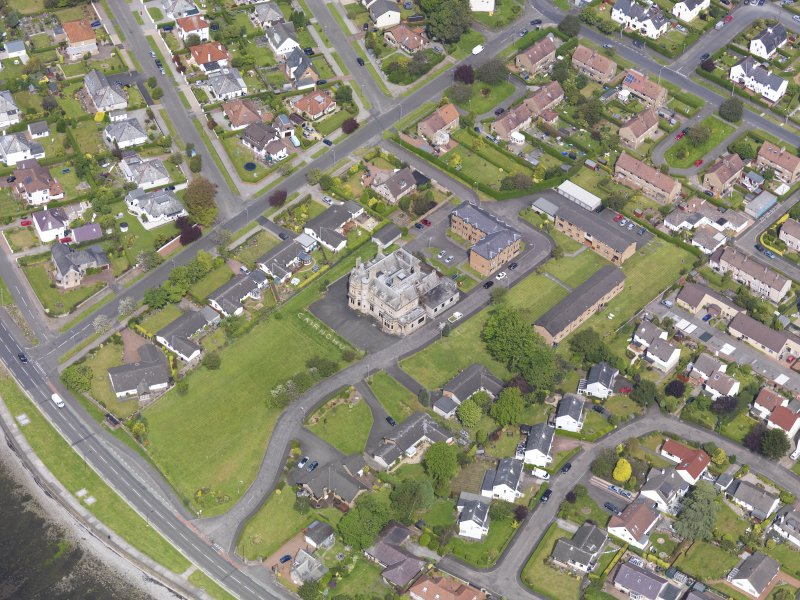 Oblique aerial view of Helensburgh, centred on Cairndhu House, taken from the SE.
