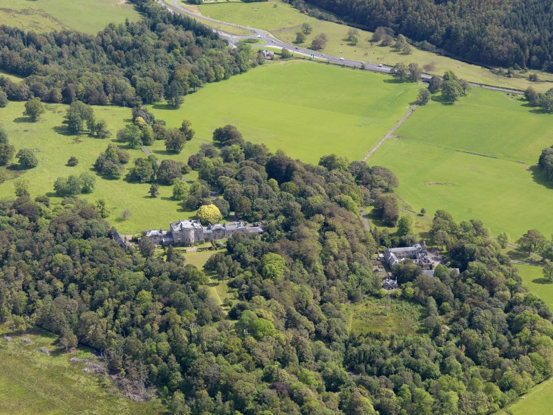 General oblique aerial view of Ardgowan House and policies, taken from the WSW.