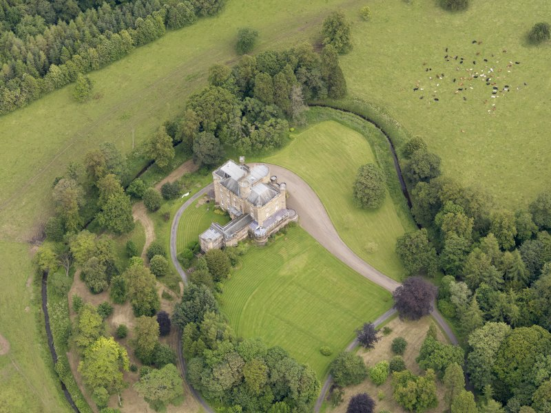 Oblique aerial view of Caprington Castle, taken from the WSW.