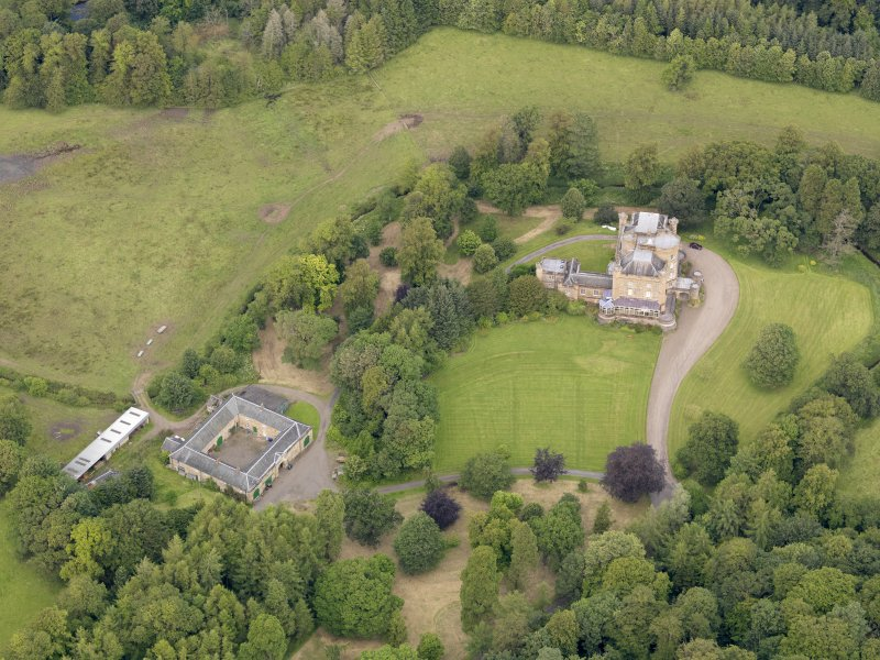 Oblique aerial view of Caprington Castle and stables, taken from the SSW.