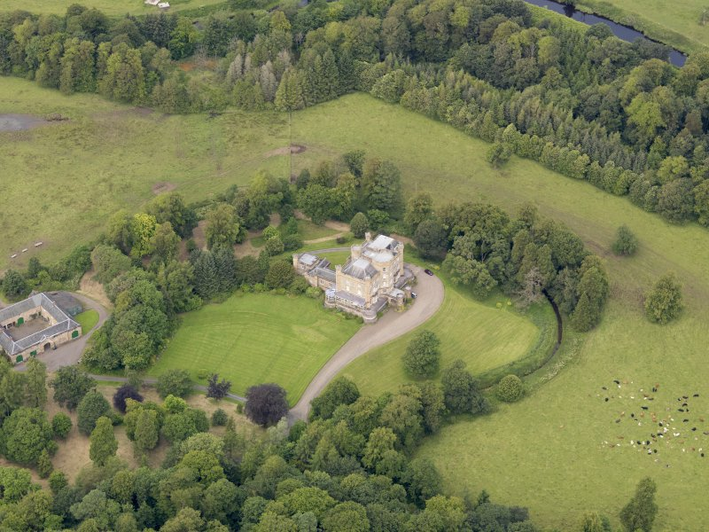 Oblique aerial view of Caprington Castle and stables, taken from the SSE.