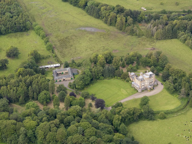 Oblique aerial view of Caprington Castle and stables, taken from the SE.