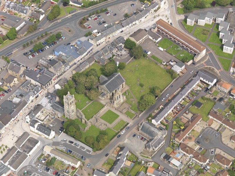 Oblique aerial view of Kilwinning Abbey, taken from the SW.