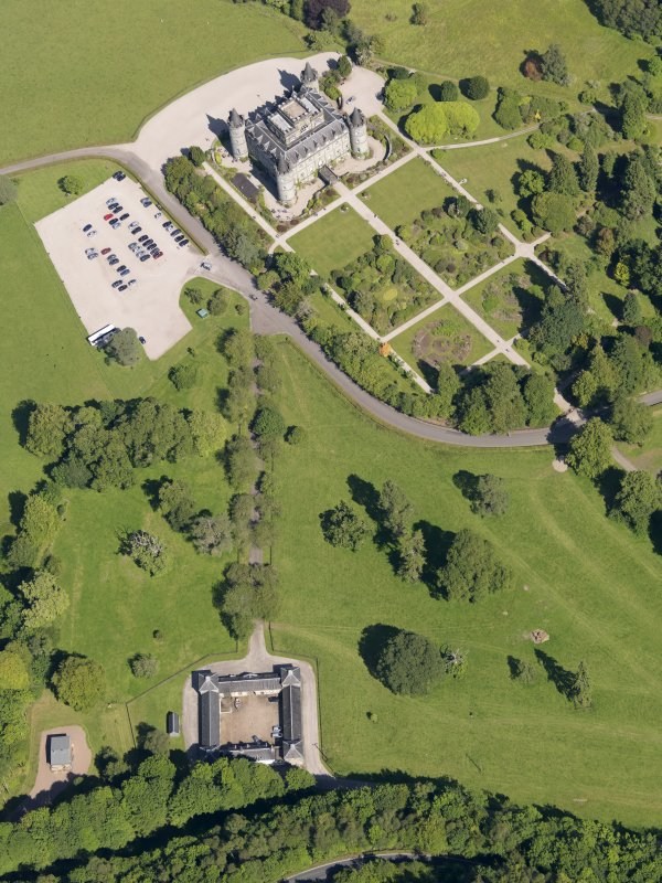 Oblique aerial view of Inveraray Castle and stables, taken from the W.