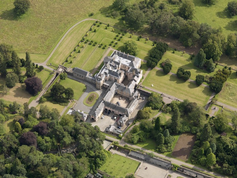 Oblique aerial view of Keir House and gardens, taken from the NNW.