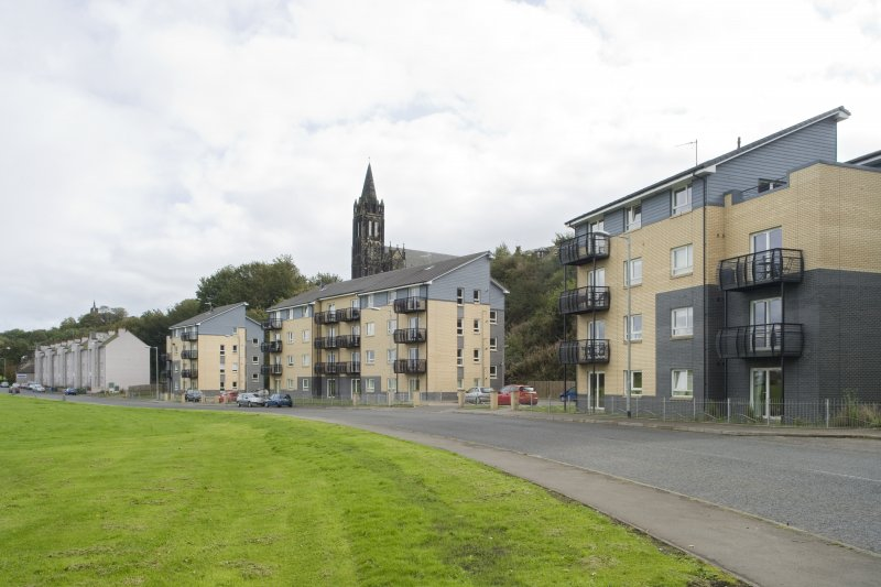 Street view showing three modern apartment blocks at 207-213 Corbiehall, Bo'ness, taken from the North-West. This photograph was taken as part of the Bo'ness Urban Survey to illustrate the character of the Corbiehall and Snab Area of Townscape Character.