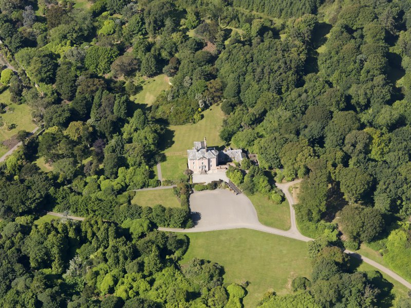 Oblique aerial view of Logan House and gardens, taken from the ENE.