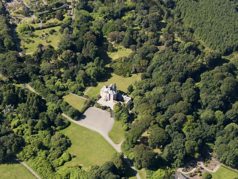 Oblique aerial view of Logan House and gardens, taken from the NE.