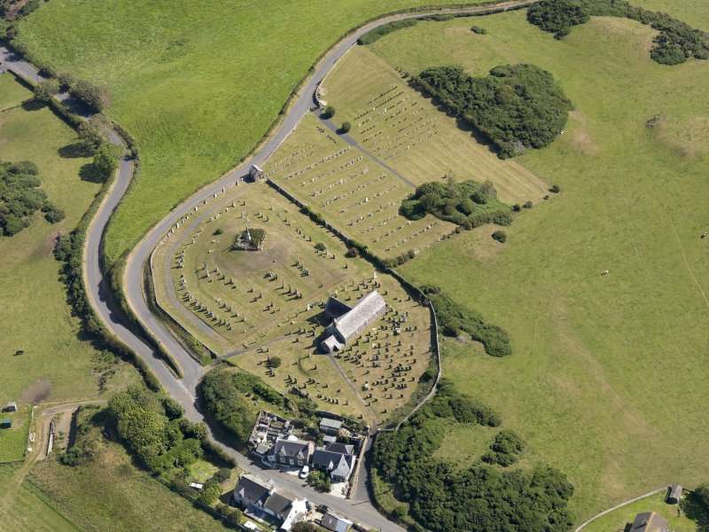 Oblique aerial view of Kirkmaiden Old Parish Church, taken from the SW.