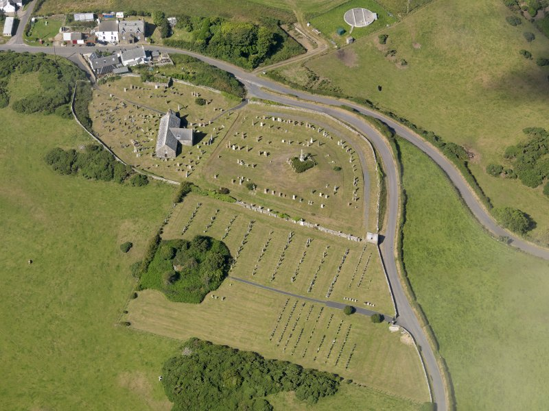 Oblique aerial view of Kirkmaiden Old Parish Church, taken from the E.