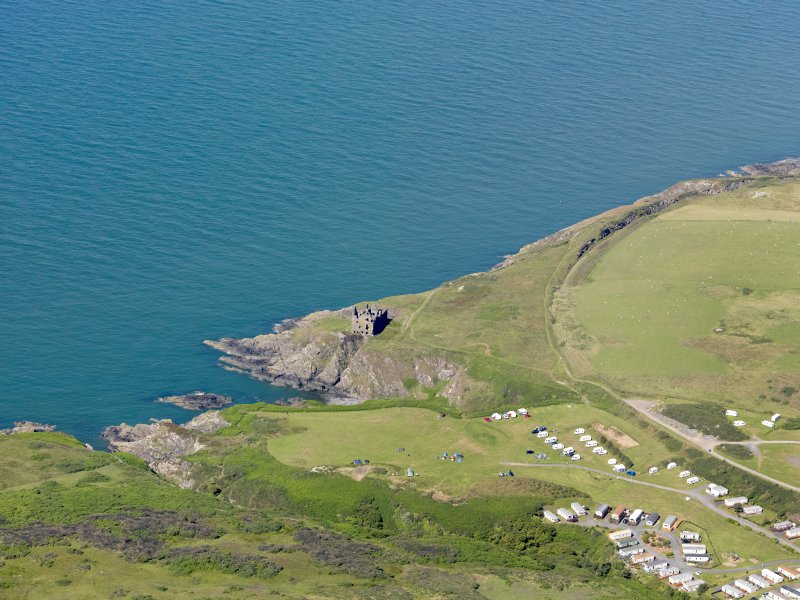 General oblique aerial view of Dunskey Castle, taken from the SE.