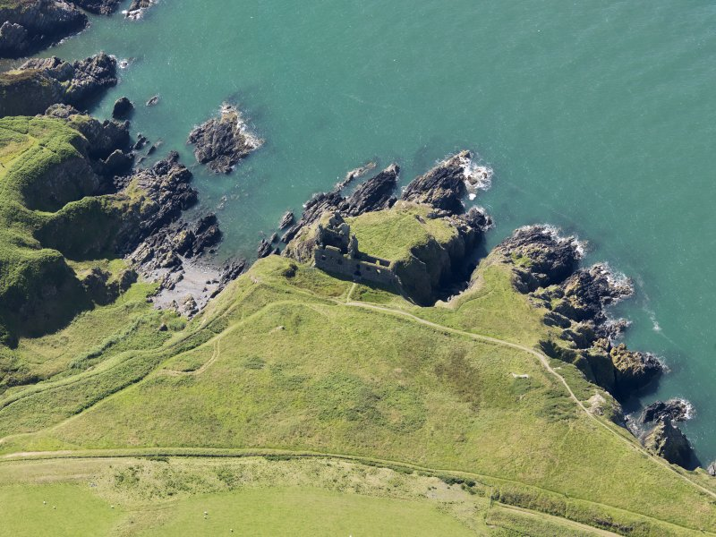 Oblique aerial view of Dunskey Castle, taken from the N.