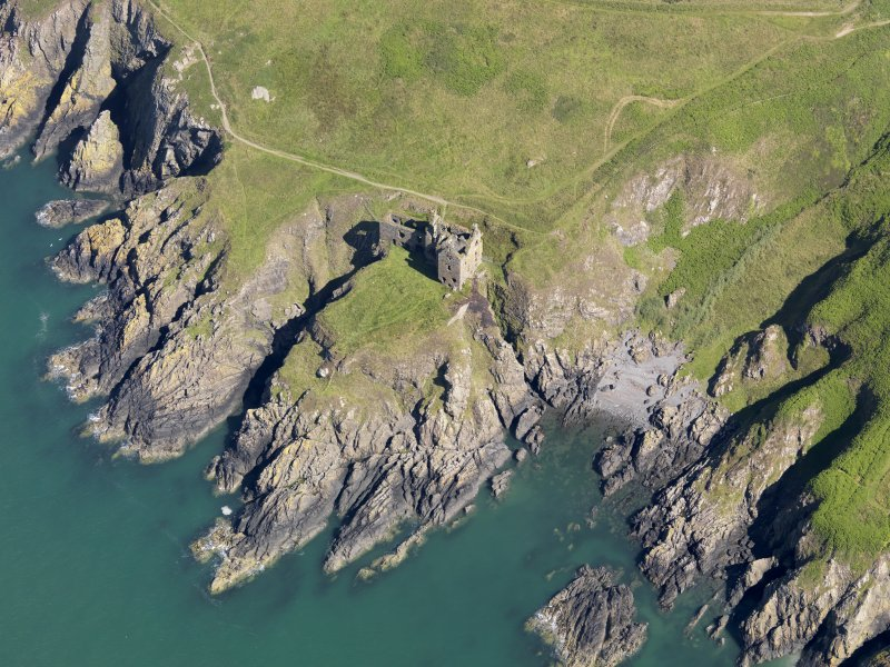 Oblique aerial view of Dunskey Castle in the Rhins of Galloway, taken from the S.