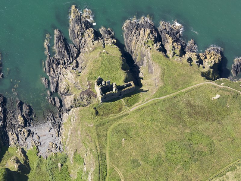 Oblique aerial view of Dunskey Castle, taken from the NE.