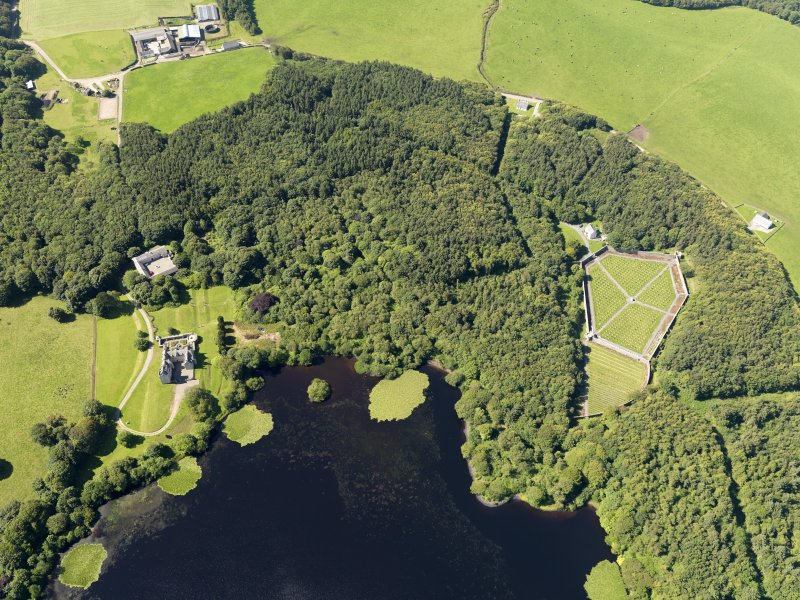 General oblique aerial view of Lochnaw Castle and policies, taken from the NE.