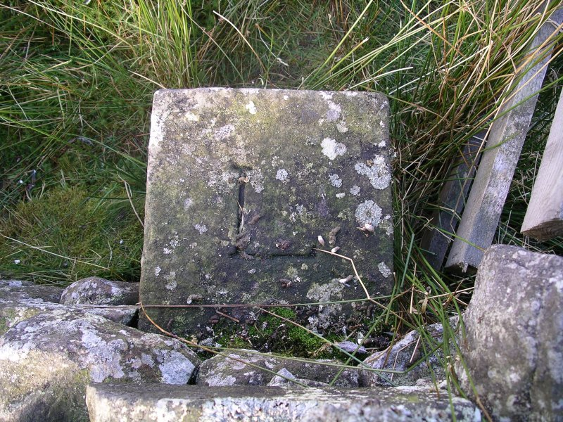 Gutterford: boundary stone in wall leading to Cock Rig summit (c NT 155 595)