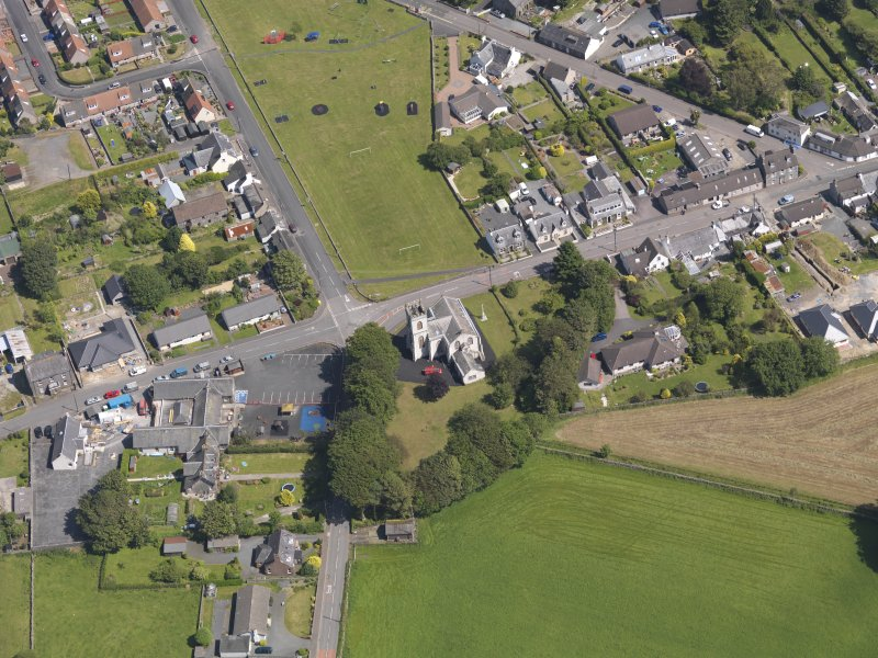 Oblique aerial view of Kirkcowan Parish Church, taken from the WSW.