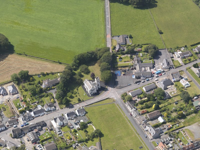 Oblique aerial view of Kirkcowan Parish Church, taken from the E.