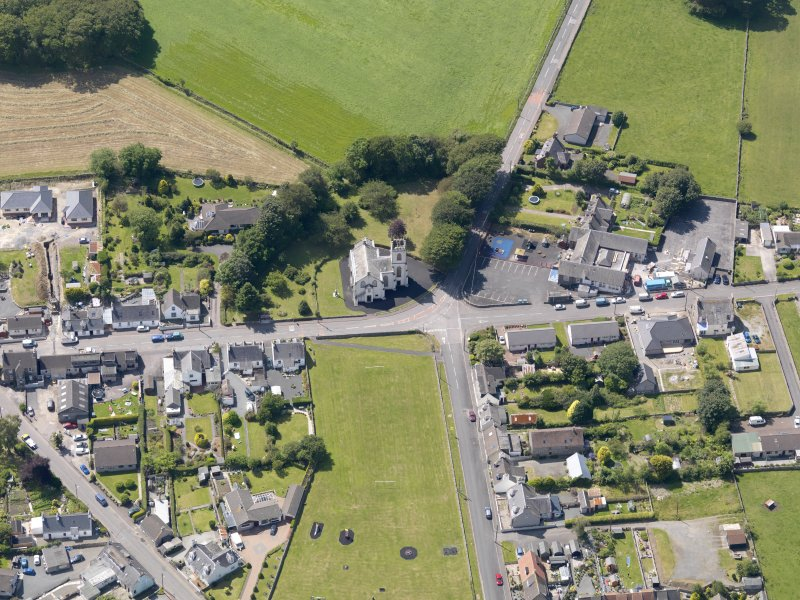 Oblique aerial view of Kirkcowan Parish Church, taken from the ENE.