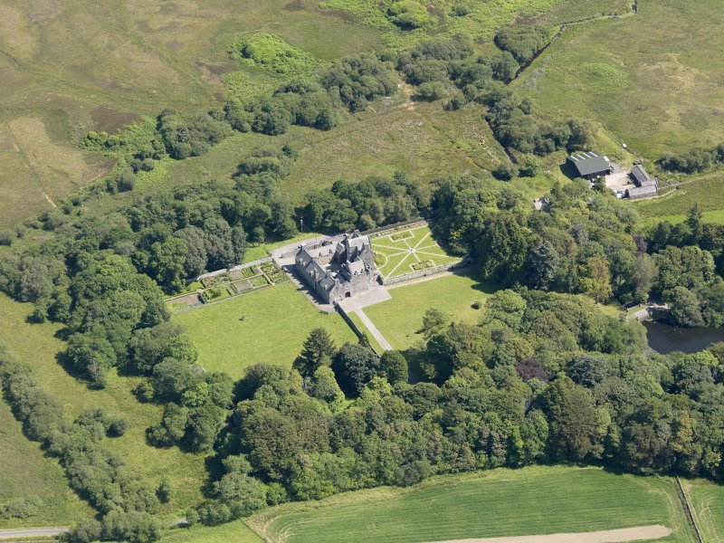 Oblique aerial view of Old Place of Mochrum, taken from the WNW.