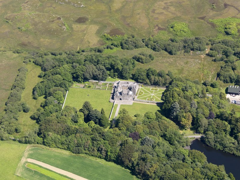 Oblique aerial view of Old Place of Mochrum, taken from the WSW.