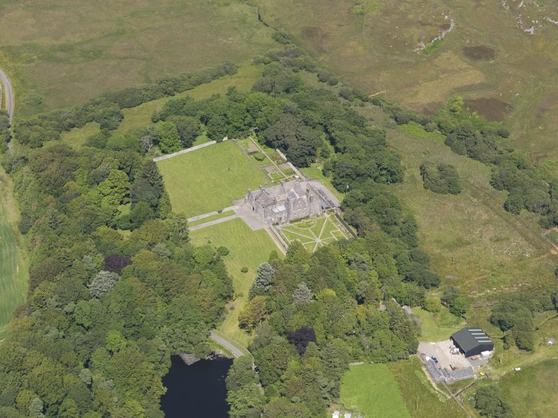 Oblique aerial view of Old Place of Mochrum, taken from the SSW.